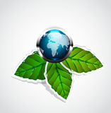 Vector earth globe on green leaves Royalty Free Stock Photos
