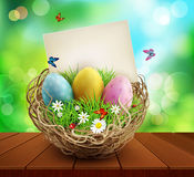 Vector easter background with basket and eggs, standing on a woo. Den table. Element for design Royalty Free Stock Photos