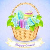 Easter bucket with flowers and decorated eggs Royalty Free Stock Image