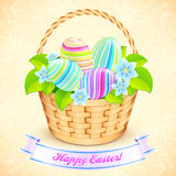 Easter bucket with flowers and decorated eggs Stock Photos