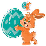 Vector easter bunny holding a decorated egg in its paws. Royalty Free Stock Photography