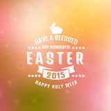 Vector Easter card. Blurred background. Have a blessed and wonderful Easter! Happy Holy Week. Typographic greeting card. Blurred background with bokeh. Vector Stock Photos