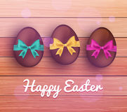 Vector easter chocolate eggs on rustic wooden Stock Images