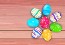 Vector easter colored eggs on rustic wooden planks Royalty Free Stock Images