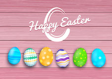 Vector easter colored eggs on rustic wooden planks Stock Photos