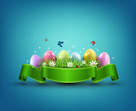 Vector Easter eggs with grass and flowers. In green ribbon isolated on a blue background. Element for celebratory design Stock Photo