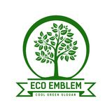 Vector Eco emblem. With a leafy green tree enclosed within a circle with a ribbon banner containing the text - Eco Emblem - and - Cool Green Slogan - below Royalty Free Stock Photography