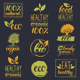 Vector eco, organic, bio logos. Handwritten healthy eat logotypes set. Vegan, natural food and drinks signs. Farm market, store icons collection. Raw meal Stock Photos