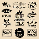 Vector eco, organic,bio logos. Vegan, natural food and drink signs. Farm market,store icons collection. Raw meal labels. Royalty Free Stock Photo