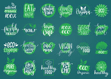 Vector eco, organic, bio signs. Vegan, healthy food illustrations set for cafe, restaurant badges, tags, packaging etc. Vector eco, organic, bio logotypes or Stock Images
