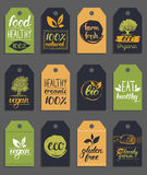 Vector eco,organic logo cards templates.Handwritten healthy eat retro logotypes set.Vegan,natural food and drinks signs. Vector eco,organic,bio logo cards Royalty Free Stock Photo