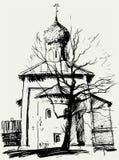 Iglesia y un árbol Fotografía de archivo libre de regalías