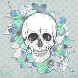 Vector el ejemplo con el cráneo humano dibujado mano, clemátide florecen libre illustration