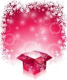 Vector el ejemplo de la Navidad con diseño tipográfico y la caja de regalo mágica brillante en fondo de los copos de nieve Foto de archivo