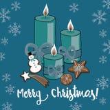 Vector el ejemplo de las velas de la Navidad con las galletas en fondo azul con los copos de nieve Feliz Navidad Fotos de archivo