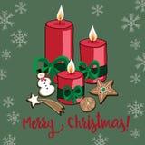 Vector el ejemplo de las velas de la Navidad con las galletas y los copos de nieve en fondo verde Feliz Navidad Imagen de archivo libre de regalías