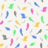 Vector el ejemplo del modelo inconsútil en colores pastel ligero con los pájaros y las ramas Imagen de archivo