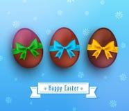 Vector el huevo de chocolate de pascua con la cinta en azul ilustración del vector