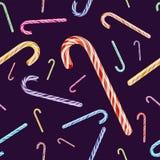 Vector el modelo inconsútil con el bastón de caramelo coloreado de la Navidad Fotos de archivo