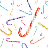 Vector el modelo inconsútil con el bastón de caramelo coloreado de la Navidad Imagen de archivo libre de regalías