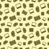 Vector el modelo inconsútil con los elementos de la cámara, de la película y de la foto retras Imágenes de archivo libres de regalías