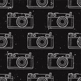 Vector el modelo inconsútil del vintage blanco y negro del grunge con las cámaras retras de la foto Fotos de archivo