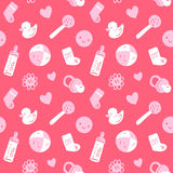 Vector el modelo rosado inconsútil del bebé con los juguetes, los smiley, bottel, calcetines, ciervos y flores Imagen de archivo libre de regalías