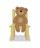 Vector el oso de peluche de la historieta que se sienta en la silla stock de ilustración