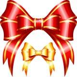 Vector el rojo y arco y cinta del regalo del oro Imagen de archivo