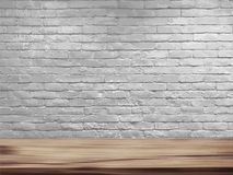 Vector empty top of natural wooden table and retro white brick wall background. Loft workspace concept royalty free stock photos
