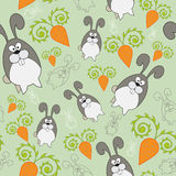 Vector endless background with rabbit and carrot Royalty Free Stock Images
