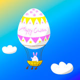 Vector EPS10 illustration rabbit pilot flies by hot air balloon looking like Easter egg Royalty Free Stock Images
