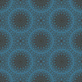 Vector ethnic seamless pattern. Circular blue ethnic seamless pattern, oriental motif, delicate symmetrical tracery on dark blue background, vector illustration Stock Photography