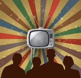 vector family watching retro tv set Stock Images
