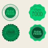 Vector farm badge set of Fresh Organic elements. Vintage style labels for natural food and drink, products, biodynamic agriculture. On the nature background Royalty Free Stock Photo