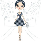 Vector fashion girl top model on the catwalk. Beautiful fashion girl top model in a smart dress with polka dot pattern and with clutch on the catwalk royalty free illustration
