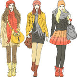 Vector fashion stylish girls in warm clothes. Set fashion stylish girls in warm pastel clothes Royalty Free Stock Photos