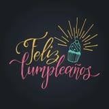 Vector Feliz Cumpleanos, translated Happy Birthday lettering design. Festive illustration with cake for greeting cards. Vector Feliz Cumpleanos, translated Stock Photo