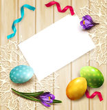 Vector festive background with Easter eggs and crocuses card. Lying on a wooden table. View from above Stock Photography