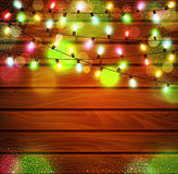 Vector festive background of luminous garlands of light bulbs on Royalty Free Stock Images