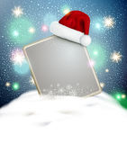Vector festive background for the New Year and Christmas. With a sign blank standing in the snow and a red cap of Santa Claus Royalty Free Stock Images