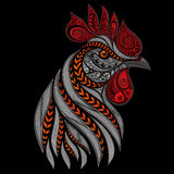 Vector fiery rooster. On a black background Stock Images