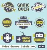 Vector fijado: Escrituras de la etiqueta e iconos del juego video de la vendimia Imágenes de archivo libres de regalías