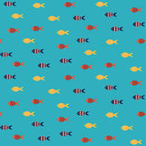 Vector fish seamless pattern. School of small yellow and red fish in rows on blue sea pattern. Summer marine theme Royalty Free Stock Image