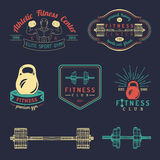 Vector fitness logos set. Hand sketched athletic signs. Gym emblems illustration. Sporting club icons for badges etc. Royalty Free Stock Images