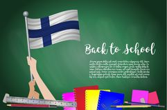Vector flag of Finland on Black chalkboard background. Education Background with Hands Holding Up of Finland flag. Back to school. With pencils, books, school Royalty Free Stock Photos