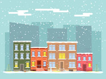 Vector flat city in winter. Street with apartment buildings in the snow Royalty Free Stock Photography