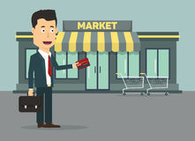 Vector flat illustration of a businessman with. Credit card going to market. Growth of fortune savings Stock Images