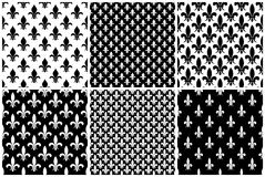 Vector fleur de lis seamless patterns set in black and white Stock Photography