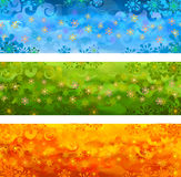 Vector floral banners. Three  floral banners - blue, green and orange Royalty Free Stock Image